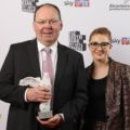 Stephen Maddock with Jess Gillam, who presented the award.