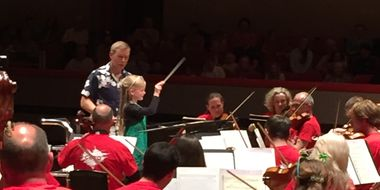 Isla conducts the CBSO. Credit: Eve Vines.