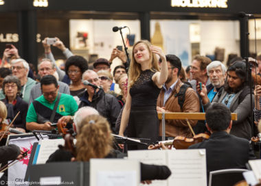 Mirga conducts the CBSO in Birmingham New Street Station.