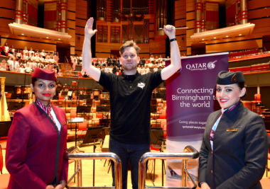 Conductor Jonathan Bloxham with Qatar's Buddika and Angela.