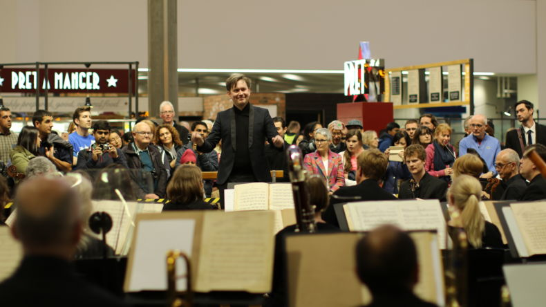 Jonathan Bloxham conducts CBSO at New Street Station.